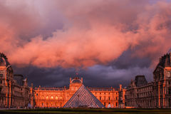 Louvre in sunset. Louvre in orange sunset, Paris Stock Photos