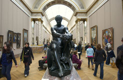 Louvre tourists visiting sculpture Stock Images