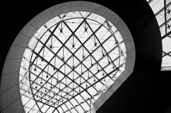 The Louvre. An unusual view of the staircase underneath the pyramid of the Louvre in Paris, France Stock Photography