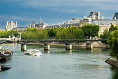 Louvre - View from Seine. View of the famous museum Louvre from the Seine river. Paris, France Stock Photo