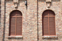 Louvre windows on wall. The louvre windows on the brick wall Royalty Free Stock Photo