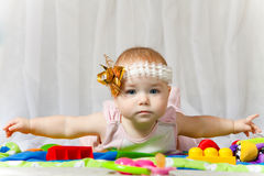 Lovable baby with arms lateral L/R Royalty Free Stock Photography