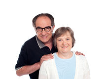 Lovable husband posing along with wife Royalty Free Stock Photography