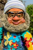 Lovable Leprechaun. It is A ceramic statue of a leprechaun with soft beard, wearing a knit hat and glasses Stock Images