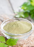 Lovage Powder on wood Stock Photos