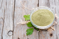 Lovage Powder on wood Royalty Free Stock Photos