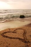 Love. An heart on the beach royalty free stock images