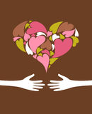 Love. Greeting card - two hands and a heart Stock Photography