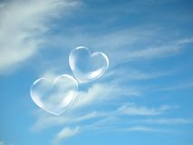 Love. Two transparent hearts with background blue sky Royalty Free Stock Photo