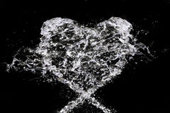 Love. Streems of water making heart sign Royalty Free Stock Image
