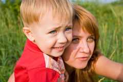 Love. Mommy and  son look in a distance Royalty Free Stock Image