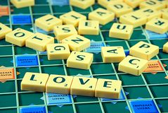 Love. Scrabble letters with word love in foreground Royalty Free Stock Photography