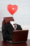 In love. Image of elegant suit without someone in it and with heartshaped balloon above Royalty Free Stock Photos