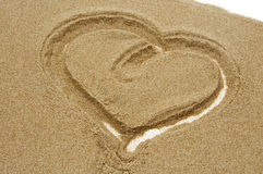 Love. Heart drawn in sand at the beach Stock Photos