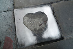 Love. A love-shape metal tile on the street of taipei Royalty Free Stock Photography