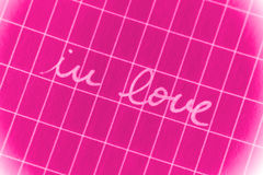 In Love. A Valentines illustration with a caption 'In Love' on a pink design Stock Photos