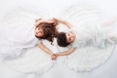 Love. Beautiful little angels. Isolated over white background Royalty Free Stock Photo