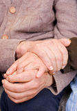 Love. Old couple holding the hands Stock Photo