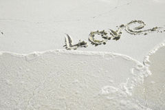 Love. Word love on white sand Stock Image