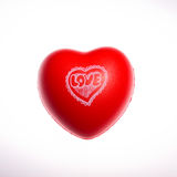 Love. Red rubber heart by clipping royalty free stock images