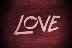 Love. The word Love written with chalk on a blackboard Royalty Free Stock Image