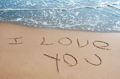 Love. I love you written on the sand of a beach Stock Photo