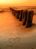 Love. Image of the heart on sand Stock Images