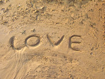 Love. Word love written in the sand Stock Images