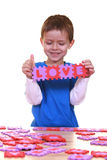 Love. Five years boy playing with letters isolated on white Stock Photo