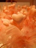 Love. Orange hearts with feathers symbolizing love Stock Photo