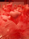 Love. Red hearts with feathers symbolizing love Stock Photography