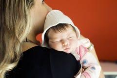 Love. The newborn girl on hands at the mum Stock Photo