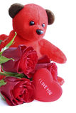 With love. Red teddy bear with roses and message on heart saying I love you Royalty Free Stock Image