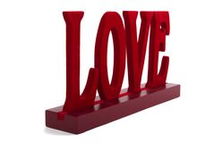 Love. Word LOVE cut out of wood and painted in red Stock Photo
