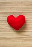 Love. Cute heart shape on wood floor Royalty Free Stock Image