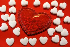 Love. A large red heart among the tiny white hearts Stock Photos