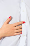 Love. Woman's hands on a sexy man's shirt Stock Image