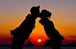 Love. Young couple kissing at the sunset Royalty Free Stock Photo