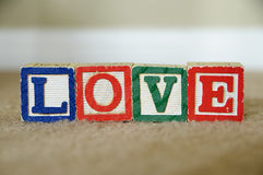 Love. The word love spelled out with toy blocks Royalty Free Stock Photo