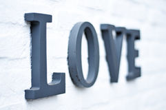 Love. Letters on a white wall stock photography