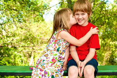 Love. First kiss at summer park Royalty Free Stock Photos