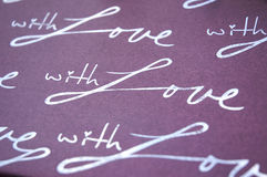 With love. The word with love on violet background Royalty Free Stock Photos