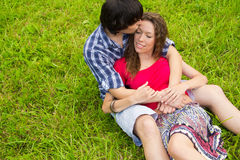 Love. COUPLE SPENDING TIME, KISSING IN PARK Royalty Free Stock Photos