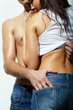 Love. Close-up of couple in jeans posing in studio Stock Photos