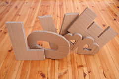 Love. Sign and hearts  made of cardboard Stock Photo