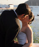 Love. A couple kissing late in the afternoon on a dock Royalty Free Stock Photos