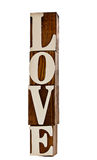 Love. Grungy wooden blocks spelling LOVE standing upright isolated over white stock photo