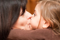 Love. Mother and her daughter kissing Stock Photo