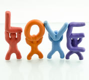 Love. Clay sculpture holds the word love on a white background Royalty Free Stock Photos