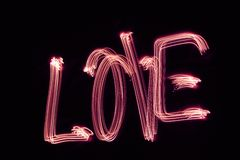 Love. The word LOVE written with light Royalty Free Stock Image